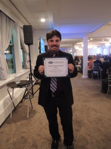 Garden City Life/Long Island Weekly editor Dave Gil de Rubio with the Third Place win for Narrative: Education for the Illustrated News. The story was based on Port Washington resident/rock violinist/music education advocate Mark Wood.