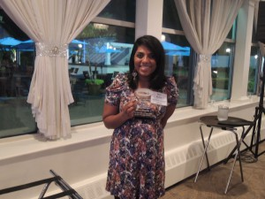 The Westbury Times/Hicksville Illustrated News editor Betsy Abraham was the big winner this evening. Here she is with her Third Place award for Narrative: Arts.