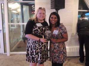 Here, Floral Park Dispatch editor Christy Hinko and Betsy Abraham show off the first place trophy they received for Best Narrative: Home & Garden.